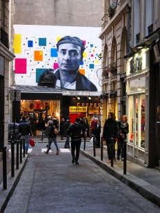 a street art graffiti with the face of a photographer paris saint germain des pres